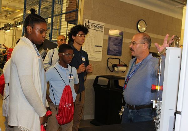 Photo of students touring a manufacturing facility